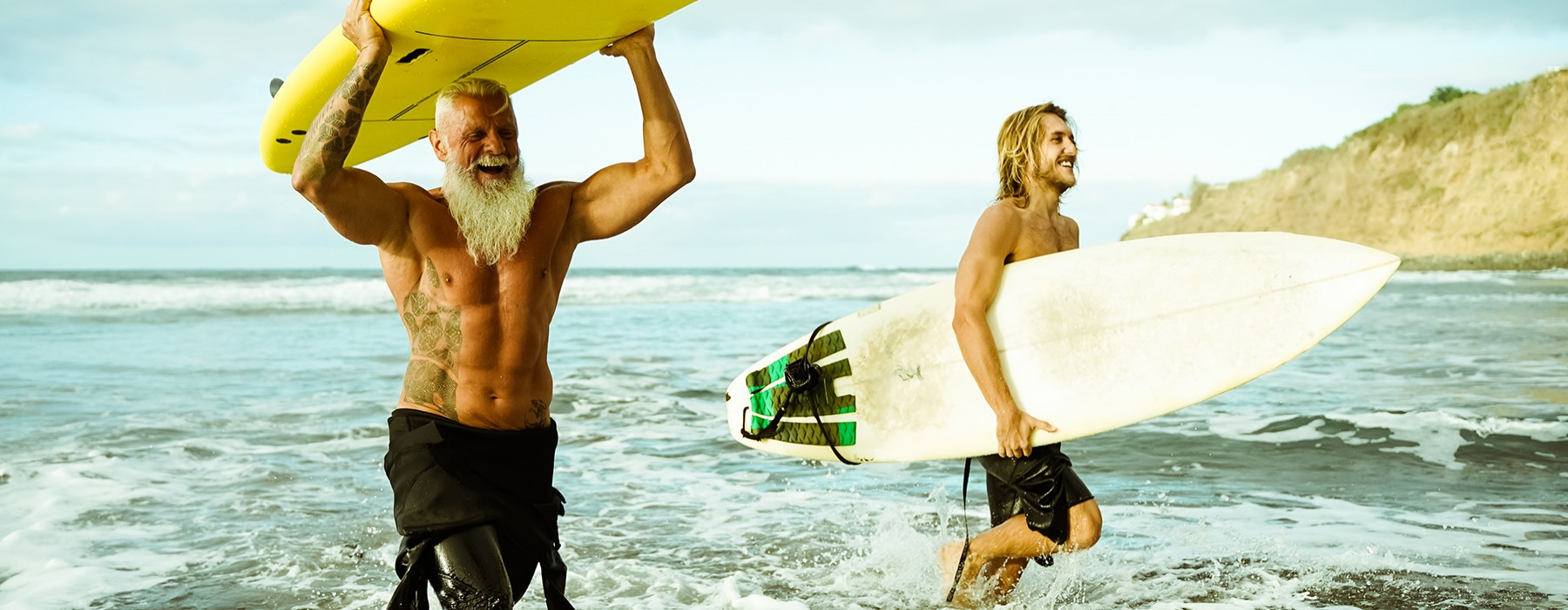 stock image of two men surfing